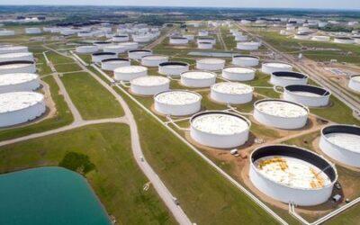Oil slides on demand concerns, strong dollar