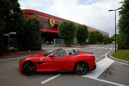 Ferrari flaunts its latest models on the catwalk